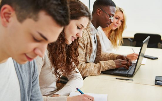 18629535 - many students learning with laptop computer in lecture of university