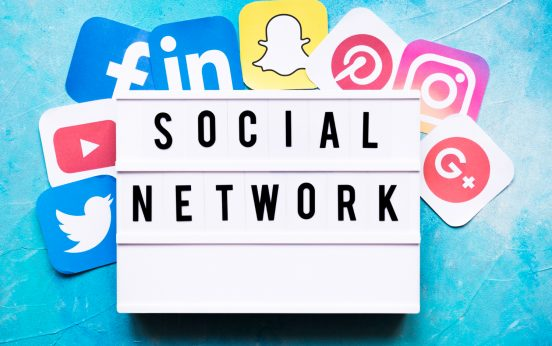 social-network-text-with-networking-application-icons-painted-wall